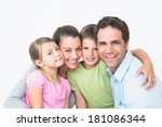 cute family smiling at camera... | Shutterstock . vector #181086344