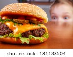 hungry young boy is staring... | Shutterstock . vector #181133504