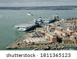 Aerial view of the two largest ships in the Royal Navy, the aircraft carriers Queen Elizabeth and the Prince of Wales moored beside each other in Portsmouth Harbour, Hampshire.