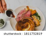 Small photo of Sunday Roast Beef with Yorkshire Pudding, Roast Potatoes, Carrots, Parsnip, Broccoli and Gravy