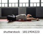 Woman Practicing Yoga  Lying In ...
