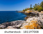 Scenic Shoreline Of A Small...