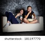 two young girl looks tv at dark ... | Shutterstock . vector #181197770