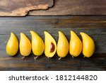 Eggfruit Or Canistel On Wooden...