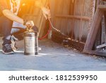 Small photo of Employees at a termite control company are using a chemical sprayer to get rid of termites at customers' homes and search for termite nests to eradicate them. Chemical spray ideas to prevent insects.