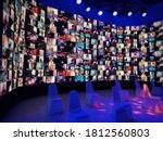 Small photo of Blur large LED screen show many people's faces join big online event or virtual reality live conference. Video conference, Work from home, Social distancing, New normal event production.