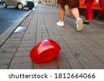 Red Balloon Lying On The...