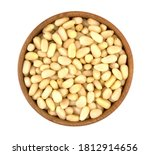 Bowl with pine nuts on white background, delicious, natural