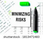 Small photo of Minimizing risk . Business concept for Analyzing Performance written on notepad with space.Balance sheet in stockholder report book