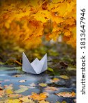 Paper Boat On An Autumn River...