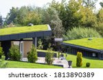 Modern buildings with lawns on...