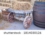 An Old Hay Cart And Barrels....