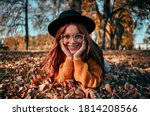 Young Woman In Park In Autumn....
