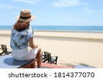 A Traveler Woman Sitting On Th...
