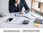 Small photo of Business Financing Accounting Banking Concept, businessman doing finances and calculate about cost to real estate investment and in other, tax system.