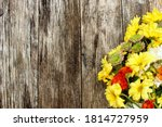 Fall Flowers On A Rustic Wood...