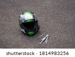 Motorcycle helmet at ground and ...