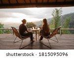 Happy Couple Sit On Wicker...