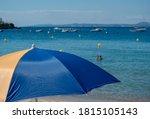 Beach Colorful Umbrella On A...