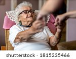 Female Home Carer Supporting...