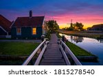 Small photo of Sunset river village scene. River bridge in sunset village. Sunset village scene. Village sunset sky landscape
