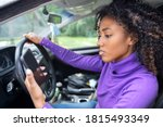 Woman Driving Car Distracted By ...