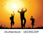 Father With Sons Walk At Sunset