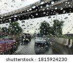Rain Falling On Car Windshield...