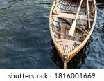 Bow Of A Wooden Boat With Oars