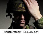 soldier with face in shadow | Shutterstock . vector #181602524