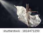 Ballerina jumping in white silk ...