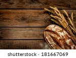 rustic bread and wheat on an... | Shutterstock . vector #181667069
