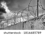Barbed Wire On Grey Clouds...
