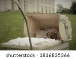An Old Baby Carriage With The...