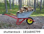 Pile Of Wood In A Wheel Barrow...