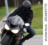 Handsome Motorcyclist In Black...