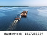 A Large Barge With Sand Sails...