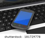 mobile phone on a laptop  | Shutterstock . vector #181729778