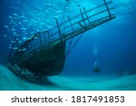 Small photo of Women diver explores the wrecks at the Bridge dive site on the island of Sint Maarten, Dutch Caribbean