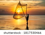 Shadow Fishermen In The Early...