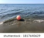 The Buoy Washed Up On The Beach
