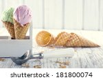 Stock photo pink and green ice cream cones with an old metal scoop on wooden rustic background with vintage 181800074
