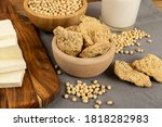 Raw dehydrated soy meat or soya chunks in wood bowl on vintage rustic background. Texturized vegetable protein, also known as textured soy protein or TSP