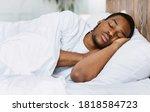 Asleep African American Guy...