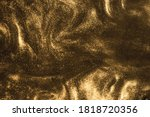 Small photo of de-focused. Abstract elegant, detailed black and gold glitter shimmer particles flow with shallow depth of field. Holiday magic shimmering luxury background. Festive sparkles and lights.