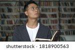 Asian Boy In Eyeglasses Holding ...