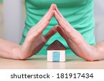 little paper house in hand... | Shutterstock . vector #181917434
