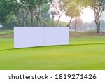 Small photo of Mockup image of Blank billboard white screen posters billboard for advertising Sponsor in Golf course activity.