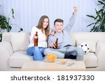 relaxed young couple watching... | Shutterstock . vector #181937330