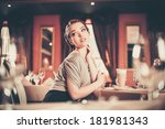 beautiful young woman with cup...   Shutterstock . vector #181981343